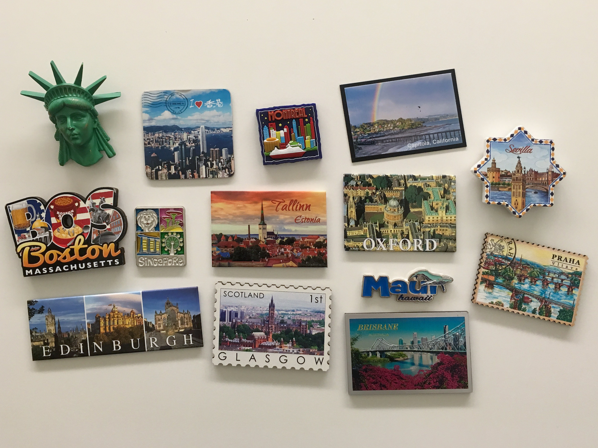 A collection of magnets commemorating different locations.